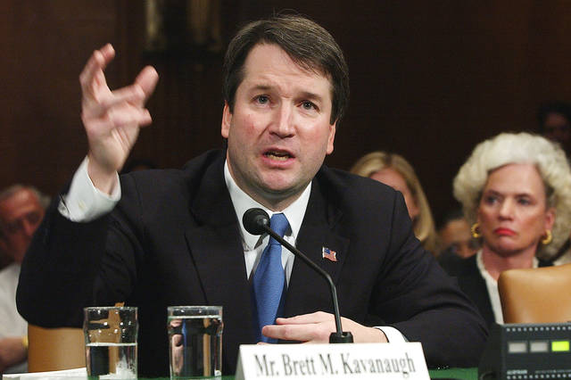 FILE -In this April 26, 2004, file photo,  Brett Kavanaugh appears before the Senate Judiciary Committee on Capitol Hill in Washington. Kavanaugh is on President Donald Trump's list of potential Supreme Court Justice candidates to fill the spot vacated by retiring Justice Anthony Kennedy. (AP Photo/Dennis Cook, File)