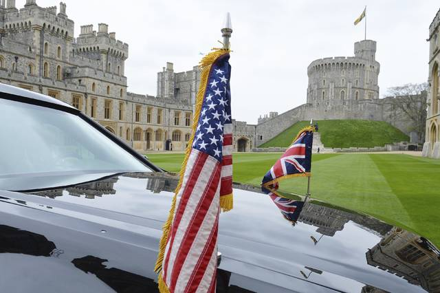 FILE - In this April 22, 2016 file photo a view of a  US Presidential Cadillac in the quadrangle of Windsor Castle, in Windsor, England. U.S. President Donald Trump's visit to Britain next week will take him to a palace, a country mansion and a castle _ and keep him away from noisy protests in London. Prime Minister Theresa May's office says Trump arrives Thursday, July 12, 2018 and will attend a dinner with business leaders at Blenheim Palace, Winston Churchill's birthplace. Trump will also travel to Windsor Castle for an audience with Queen Elizabeth II. (Steve Parsons/PA via AP, File)