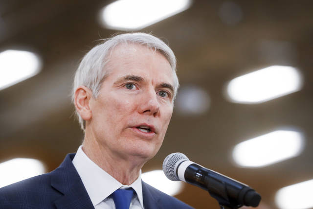 FILE - In this April 16, 2018 file photo, Sen. Rob Portman, R-Ohio, speaks during a news conference at a Kroger supermarket as the company announces new associate benefits attributed to the Tax Cuts and Jobs Act, in Cincinnati.  Portman, a U.S. trade representative during George W. Bush's presidency, says he supports being tough with China but would like to see more caution and more negotiation with the European Union, Canada and Mexico. The United States and China launched a trade war with each other Friday, July 6. The Trump administration's tariffs on imported steel and aluminum from U.S. allies have also triggered trade retaliation. (AP Photo/John Minchillo, File)