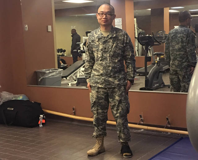 "This photo provided by Panshu Zhao shows Zhao in uniform on Feb. 11, 2018 at a U.S. Army Reserve installation in Houston.  Zhao is one of dozens, if not more, devastated immigrant military recruits and reservists struggling this summer with abrupt and often inexplicable discharges and cancelled contracts. They enlisted with a promised path to citizenship in exchange for being willing to risk their lives for the U.S., a timeworn exchange that's added linguists, medical specialists and others to the military since the Revolutionary War.  ""It's just like you're dropped from heaven to hell,"" Zhao told the Associated Press on Friday, July 6, 2018.  (Panshu Zhao via AP)"