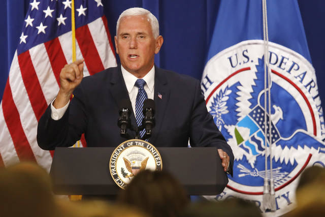 "Vice President Mike Pence speaks at U.S. Immigration and Customs Enforcement (ICE), at ICE headquarters, Friday, July 6, 2018, in Washington. Pence is defending federal immigration authorities charged with detaining and deporting unauthorized immigrants and accusing Democrats of making opposition to the agency the ""center"" of their party. (AP Photo/Jacquelyn Martin)"