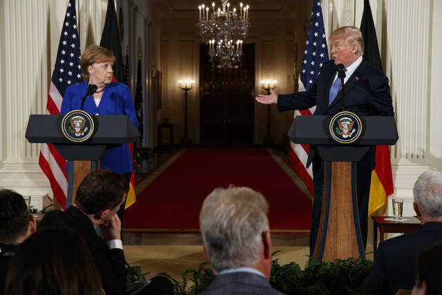 "FILE - In this file photo from April 27, 2018, President Donald Trump speaks during a news conference with German Chancellor Angela Merkel in the East Room of the White House in Washington. Trump said in Brussels on Wednesday, July 11, 2018, that a pipeline project has made Germany ""totally controlled"" by and ""captive to Russia."" The steady drum of anti-German rhetoric from one of the country's traditionally closest friends has started people wondering whether to get ready for a messy breakup. (AP Photo/Evan Vucci, File)"