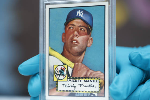 "The ""Holy Grail"" of baseball cards, a 1952 Topps Mickey Mantle that is valued at more than $10 million, is put on display as part of baseball memorabilia exhibit at the Colorado History Museum Monday, July 16, 2018, in Denver. The pristine card, one of three known to still be in existence, is owned by Denver lawyer Marshall Fogell. (AP Photo/David Zalubowski)"