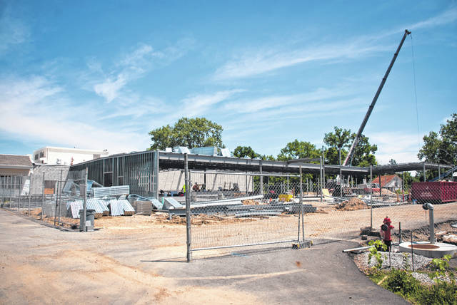 "Though it was mid-July when the photo was taken and the only visible signs of the new building were the steel I-beams for the framing, the school district is hopeful of moving into the building sometime during the 2018-2019 school year. ""We're looking at occupying Buckeye Valley East (Ashley) at the end of January 2019,"" said Andrew Miller, Buckeye Valley Local Schools superintendent."