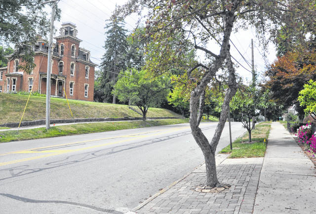 Developer Jim Manos is seeking approval from the city to renovate the historic Perkins House, left, and build an additional structure behind the home to create a 43-room hotel adjacent to the Ohio Wesleyan University campus. Residents on West William Street, however, are concerned about the possibility of losing their on-street parking spaces on the north side of the street, pictured to the right, in order to create a left-turn lane into the proposed hotel.