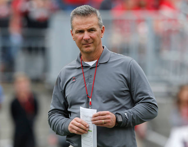 FILE - In this April 14, 2018, file photo, Ohio State coach Urban Meyer watches the NCAA college football team's spring game in Columbus, Ohio. Ohio State has placed Meyer on paid administrative leave while it investigates claims that his wife knew about allegations of abuse against an assistant coach years before he was fired last week. (AP Photo/Jay LaPrete, File)