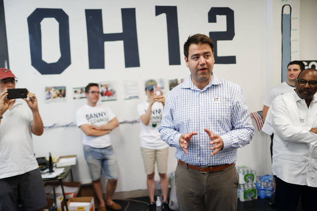 FILE – In this Aug. 7, 2018, file photo, Franklin County, Ohio, Recorder Danny O'Connor, center, the Democratic candidate running to succeed former Republican U.S. Rep. Pat Tiberi in Ohio's 12th District, speaks to volunteers and supporters at his campaign headquarters in Columbus, Ohio. It's rare two candidates for a coveted open congressional seat get a do-over, but after O'Connor and Ohio state Sen. Troy Balderson, the Republican candidate, fought to a razor-thin finish in the Aug. 7, 2018, special election to fill the final months of Tiberi's unexpired term, the two again face off in the Nov. 6, 2018, general election to win a full, two-year term. (AP Photo/John Minchillo, File)