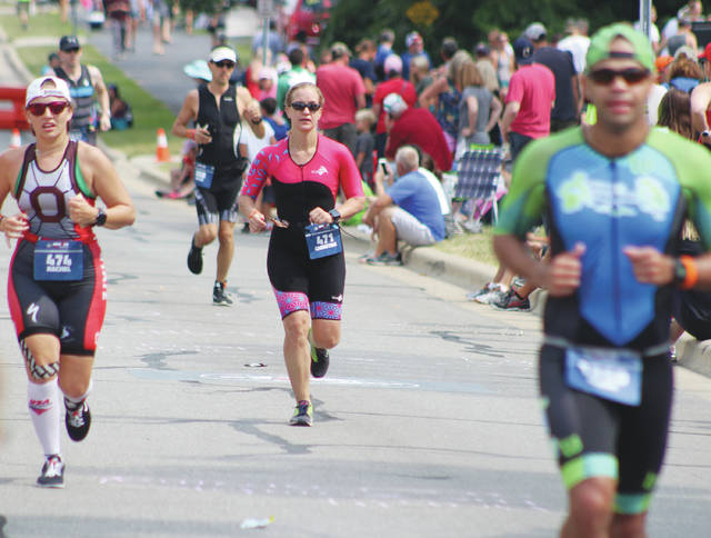 Ironman 70.3 Ohio competitors run down South Henry St. in front of OWU's Selby Stadium.