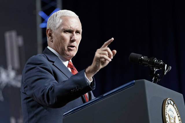 "FILE - In this Aug. 23, 2018, file photo, Vice President Mike Pence speaks during a visit to NASA's Johnson Space Center in Houston. Pence says he's ""100 percent confident"" that no one on his staff was involved with the anonymous New York Times column criticizing President Donald Trump's leadership. (AP Photo/David J. Phillip, File)"