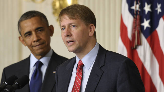 FILE - In this July 17, 2013 file photo, President Barack Obama, left, listens as Richard Cordray, right, the new director of the Consumer Financial Protection Bureau, speaks in the State Dining Room of the White House in Washington. Washington-based GMMB recently has been making Ohio ad buys for Democrat Cordray's gubernatorial campaign against Republican Attorney General Mike DeWine, according to records reviewed by The Associated Press. The two are locked in a high-profile fight for the office Republican Gov. John Kasich vacates in January 2019 because of term limits. (AP Photo/Susan Walsh, File)